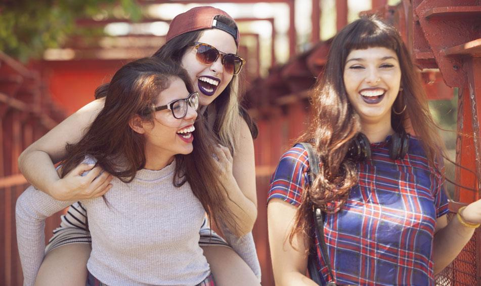 three sober girls laughing